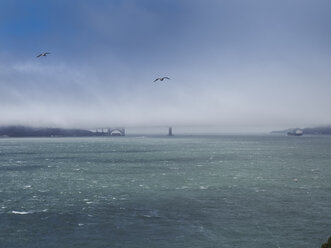 USA, San Francisco, view to Golden Gate Bridge in fog from Alcatraz island - SBDF002320