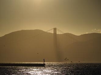 USA, San Francisco, Golden Gate Bridge at sunset - SBDF002326