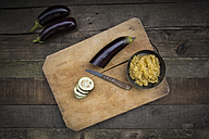 Bowl of Baba Ghanoush, aubergines on chopping board - LVF003998