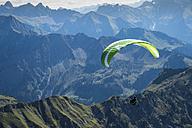 Germany, Bavaria, Oberstdorf, paraglider flying from Nebelhorn to the valley - FR000341
