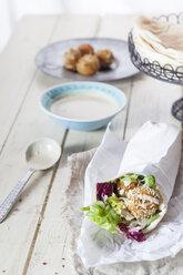 Homemade falafel with lettuce, tahini sauce in flat bread, Dueruem - SBDF002358