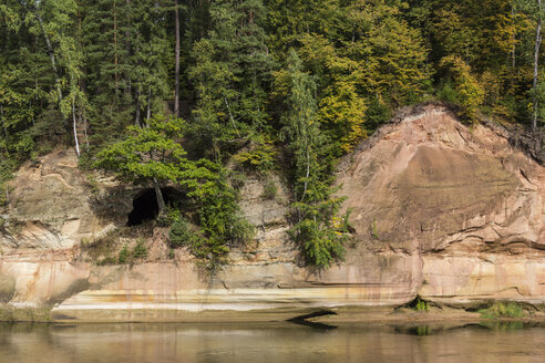 Latvia, Gauja National Park, Devil's cave, forest and sandstone rocks at the Gauja river - MELF000097