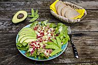Quinoa salad with feta, pomegranate, avocado and snow peas on plate - SARF002207