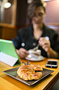 Plate with croissant in a coffee shop - MGOF000847