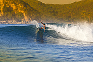 Indonesia, Lombok, surfing man - KNTF000115