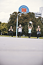 Four women having an outdoor boot camp workout - MADF000528