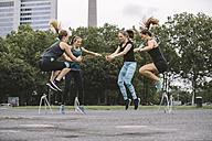 Four women having an outdoor workout - MADF000537