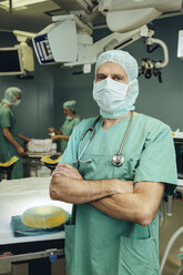 Portrait of confident surgeon in operating room - MFF002326