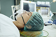 Narcotized patient with a respiratory mask on operating table - MFF002350