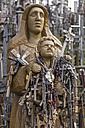 Lithuania, Siauliai, statue over and over covered with crosses at the Hill of Crosses - MEL000107