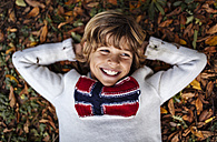 Portrait of smiling blond boy wearing  pullover with Norwegian Flag - MGOF000874