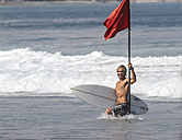 Surfer holding a red flag - KNTF000127