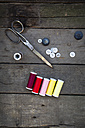 Scissors, buttons and cotton reels on wood - LVF004041