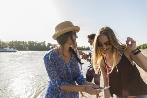 Happy friends at the river in summer - UUF005865