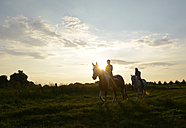 Young women riding into the sunset - BFRF001560