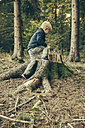 Little boy climbing on stump of spruce tree - MFF002436
