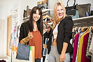 Young women in fashion boutique shopping for clothes - JASF000199