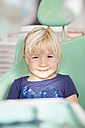 Portrait of smiling girl in dentist's chair - FKF001471