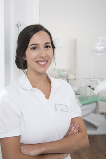 Portrait of smiling dentist at surgery - FKF001489