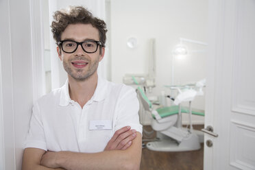 Portrait of smiling dentist at surgery - FKF001495