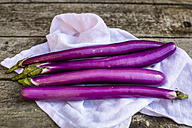 Aubergines on kitchen towel - SARF002228