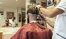 Barber shaving head of a customer - MGOF000883