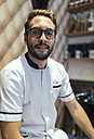 Portrait of barber with full beard and glasses - MGOF000904