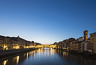 Italy, Tuscany, Florence, View of Arno River and Ponte Vecchio in the evening - FOF008345