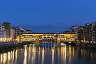 Italy, Tuscany, Florence, View of Arno River and Ponte Vecchio in the evening - FOF008348