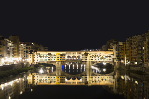 Italy, Tuscany, Florence, View of Arno River and Ponte Vecchio at night - FOF008351