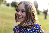 Portrait of smiling blond girl with freckles - MGOF000939