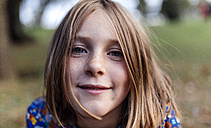 Portrait of smiling girl with freckles - MGOF000945