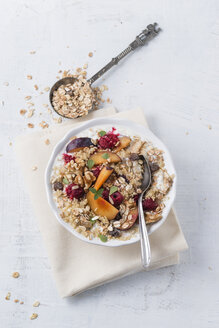 Bowl of soured milk with quinoa, fruit muesli, plums and raspberries - MYF001180