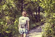 Russia, Saint Petersburg, back view of woman with backpack walking at  Shuvalovsky Park - KNTF000146