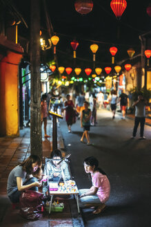 Vietnam, Hoi An, Three women working at table in the street - EH000297