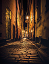 Sweden, Stockholm, Gamla Stan, lighted alley by night - MPAF000044