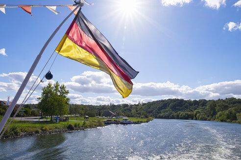 Germany, Lower Franconia, Germany flag on ferry near Volkach - SIEF006818