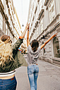Austria, Vienna, back view of two female friends exploring the old town - AIF000117