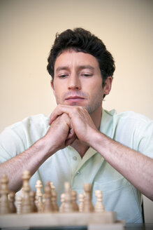 Portrait of man playing chess - RMAF000033