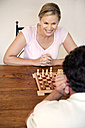 Portrait of woman playing chess with her husband - RMAF000036