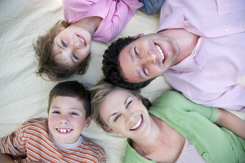 Group picture of happy family lying together on blanket - RMAF000051
