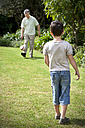 Little boy playing soccer with his grandfather - RMAF000072