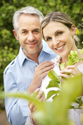 Portrait of smiling couple in the garden - RMAF000128