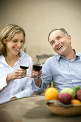 Two friends toasting with red wine - RMAF000131