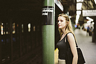USA, New York City, young woman in the subway in Manhattan - GIO000356