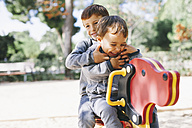 Two happy boys playing at the playground - EBSF000990