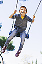 Happy boy on a swing at the playground - EBSF000999