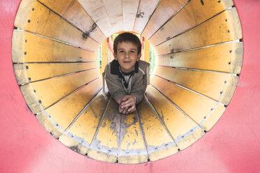 Boy in a tunnel at playground - DEGF000573