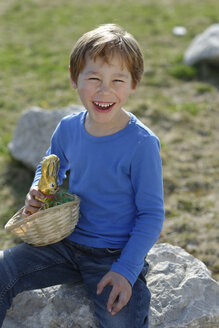 Portrait of laughing little boy with Easter nest and Easter bunny - LBF001272