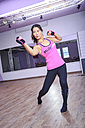 Asian woman exercising piloxing - VT000458